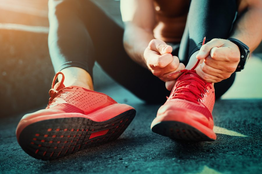 Lady tying up running shoes