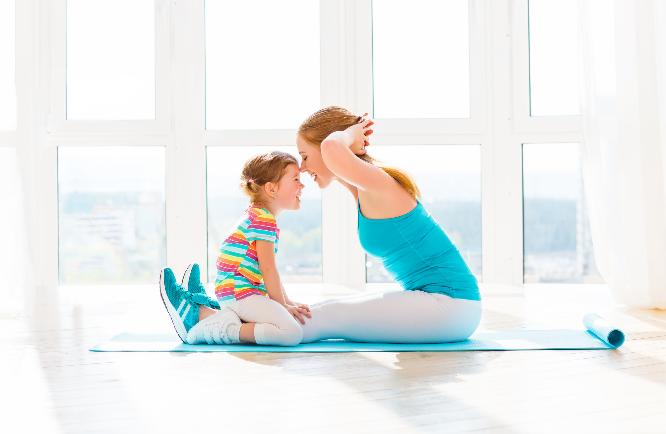 family mother and child daughter are engaged in fitness