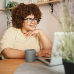 plus size woman looking at laptop